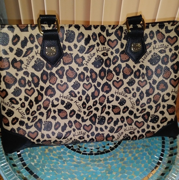 69240bf055a Hello Kitty Bags   Handbag   Poshmark
